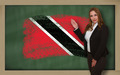 Teacher showing flag oftrinidad tobago  on blackboard for presen - PhotoDune Item for Sale