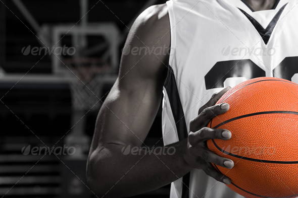 Basketball player with basketball - Stock Photo - Images
