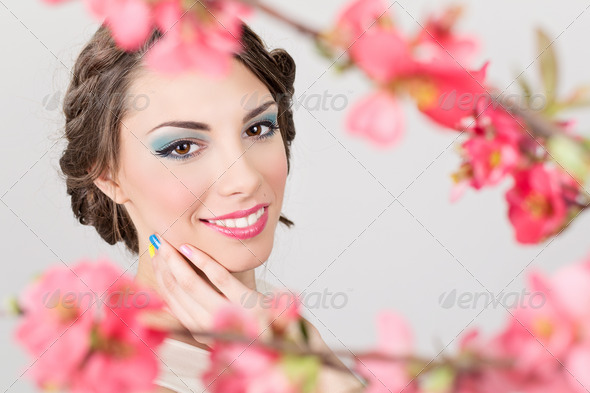 Beautiful young woman wearing colorful makeup - Stock Photo - Images