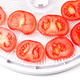 Ripe tomato on food dehydrator tray, ready to dry - PhotoDune Item for Sale