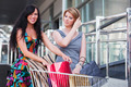Young women with shopping cart - PhotoDune Item for Sale