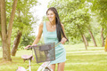Happy Attractive Girl With Bicycle - PhotoDune Item for Sale