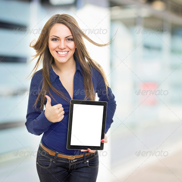 Positive young businesswoman with tablet computer - Stock Photo - Images