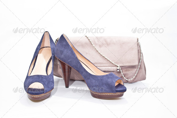 Blue shoes with pink suede handbag - Stock Photo - Images