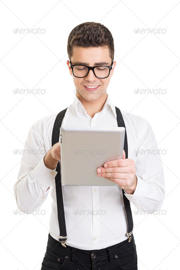 Happy handsome businessman with glasses using tablet computer - Stock Photo - Images