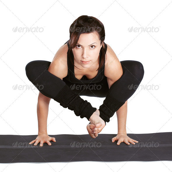 yoga excercising bhudzhapidasana - Stock Photo - Images