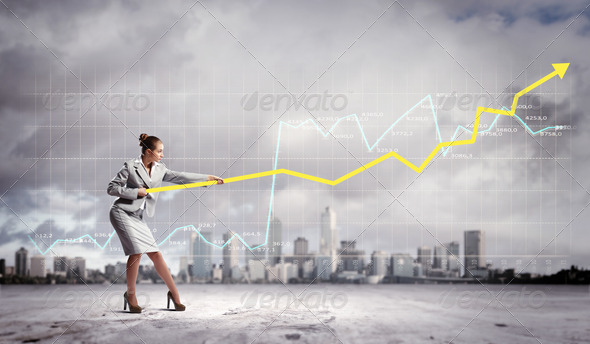 Businesswoman pulling graphic - Stock Photo - Images