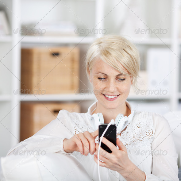 pretty woman with mobile phone and headphones - Stock Photo - Images