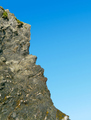 Jagged granite rock cliff edge and blue sky. - PhotoDune Item for Sale