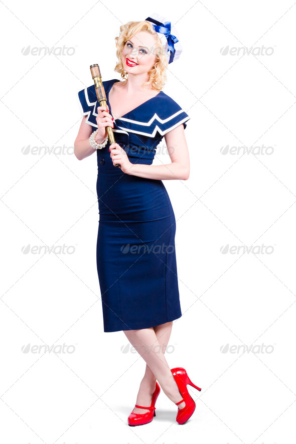 1950 maritime woman holding nautical telescope - Stock Photo - Images