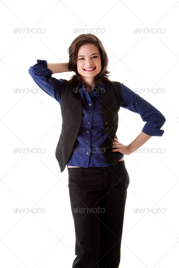 Young business woman standing smiling - Stock Photo - Images