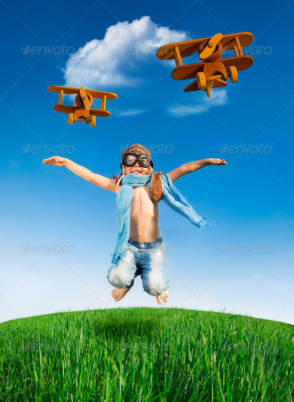 Happy kid jumping outdoors - Stock Photo - Images