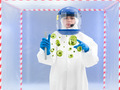 specialist in protective suit holding microorganism samples - PhotoDune Item for Sale