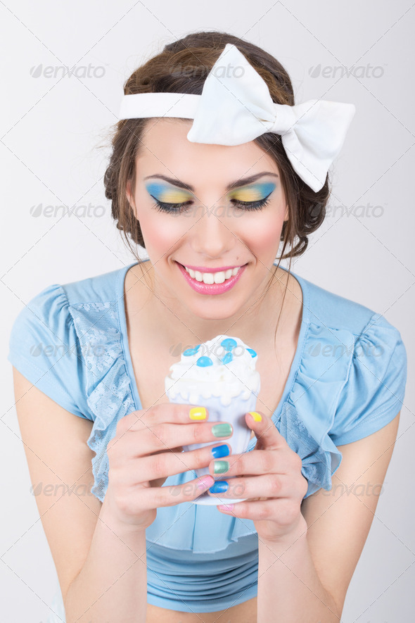 Cute retro woman in blue holding ice-cream - Stock Photo - Images