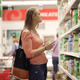 Woman Chooses Juice In The Supermarket - VideoHive Item for Sale