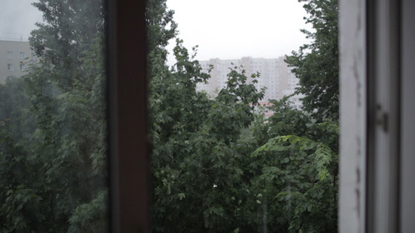 VideoHive Heavy Rain Focus Pulling From Window To Building 5123530