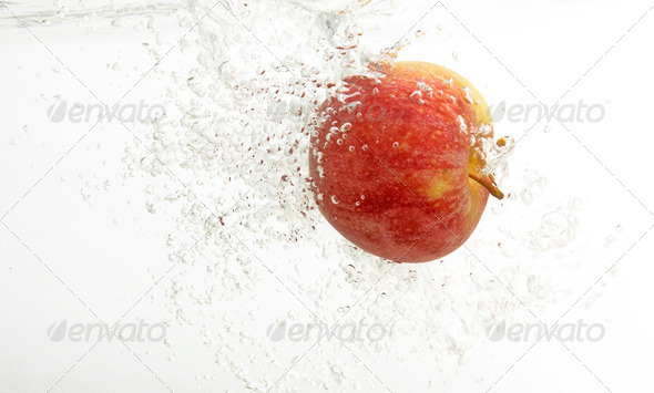 Fresh an apple in clean water. - Stock Photo - Images