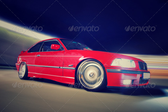 Rolling Red Car - Stock Photo - Images