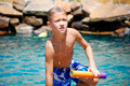 Boy getting out of swimming pool - PhotoDune Item for Sale