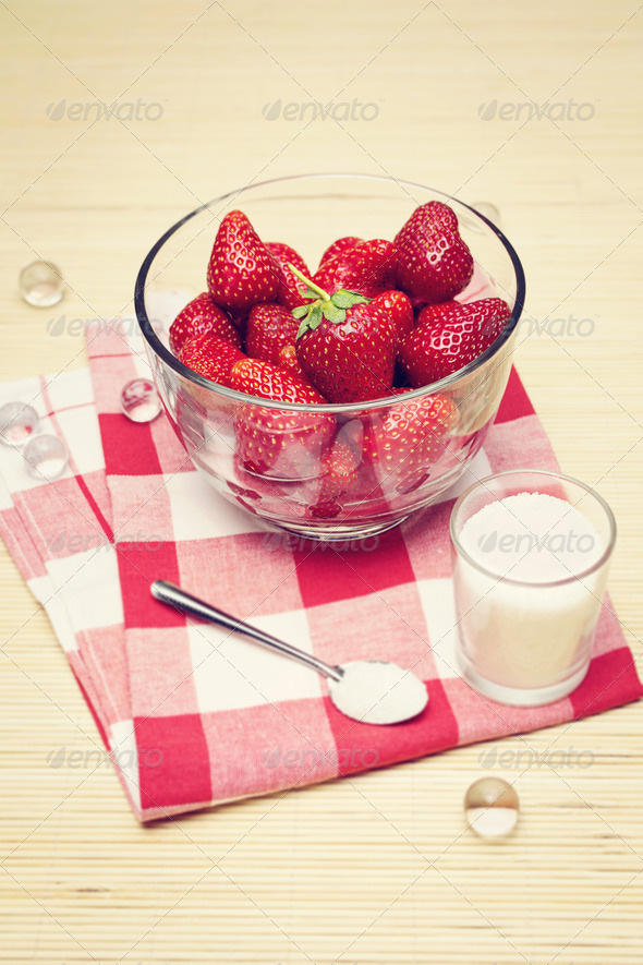 Retro edited closeup of fresh strawberries in a bowl - Stock Photo - Images