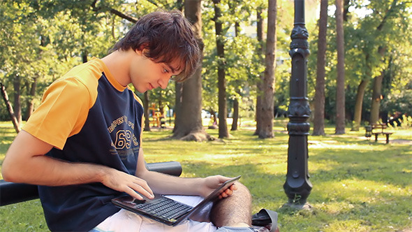 VideoHive Young Man with Laptop 5108961
