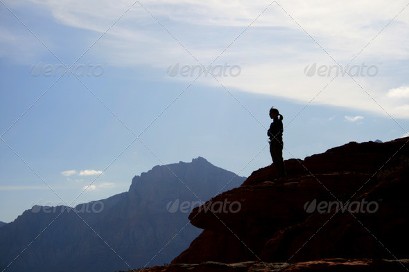 woman on sandstone cliff - Stock Photo - Images