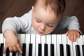 baby play music on piano keyboard - PhotoDune Item for Sale
