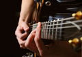 guitarist hands playing guitar over black - PhotoDune Item for Sale