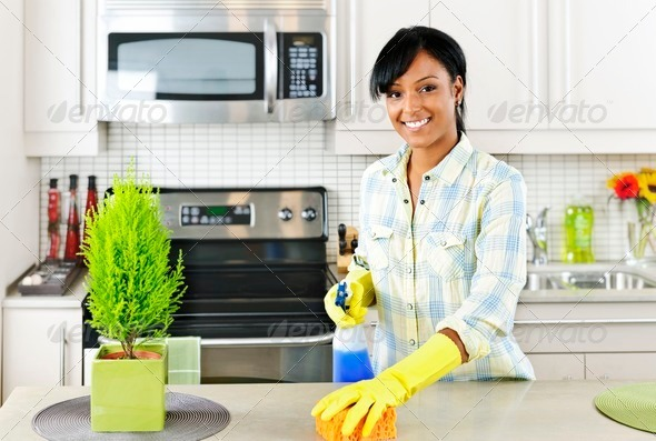 PhotoDune Young woman cleaning kitchen 537940