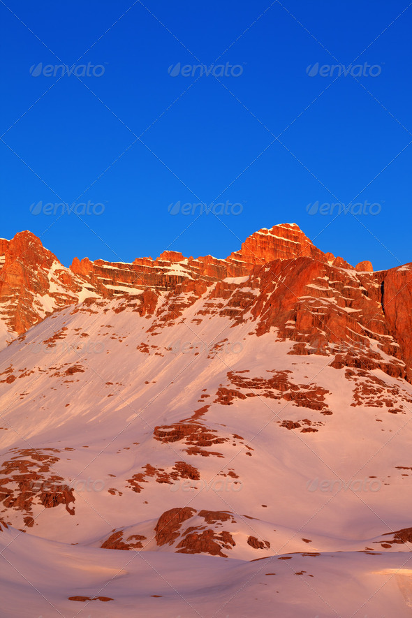 Sunrise in snow mountains - Stock Photo - Images