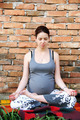 Pregnant woman doing yoga - PhotoDune Item for Sale