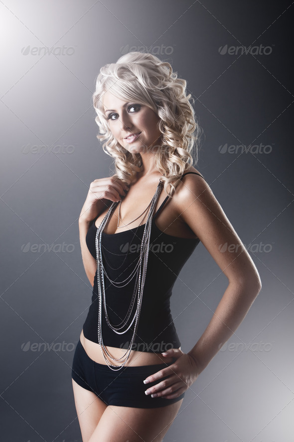 Young slim sexy woman in black tight dress - Stock Photo - Images