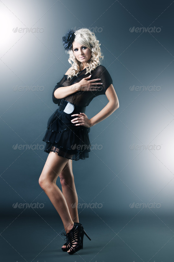 Young woman in black lace dress and high heels - Stock Photo - Images