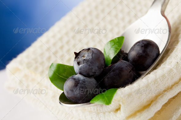 Blueberries on spoon - Stock Photo - Images
