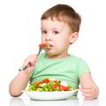 Cute little boy is eating vegetable salad - PhotoDune Item for Sale
