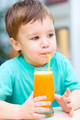Little boy with glass of orange juice - PhotoDune Item for Sale