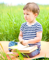 Little boy is reading book - PhotoDune Item for Sale