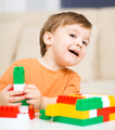 Boy is playing with building blocks - PhotoDune Item for Sale