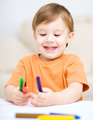 Little boy is drawing on white paper - PhotoDune Item for Sale