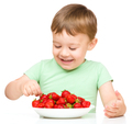 Happy little boy with strawberries - PhotoDune Item for Sale