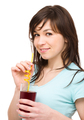 Young woman is drinking cherry juice - PhotoDune Item for Sale