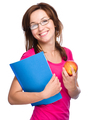 Young student girl is holding book and apple - PhotoDune Item for Sale