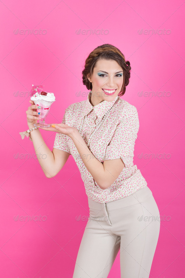 Happy young pin-up girl holding strawberry ice-cream - Stock Photo - Images