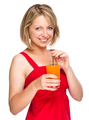 Young woman is drinking carrot juice - PhotoDune Item for Sale