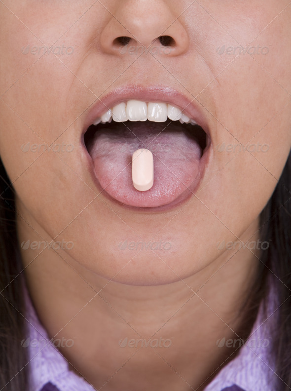 Pill on the Tongue  - Stock Photo - Images