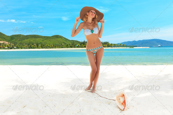 Woman on the beach - Stock Photo - Images