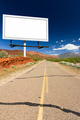 Blank Billboard Sign on Empty Desert Highway - PhotoDune Item for Sale