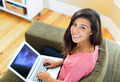 happy young woman using a laptop computer - PhotoDune Item for Sale