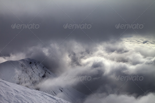 Off-piste slope and snowy rocks in bad weather - Stock Photo - Images