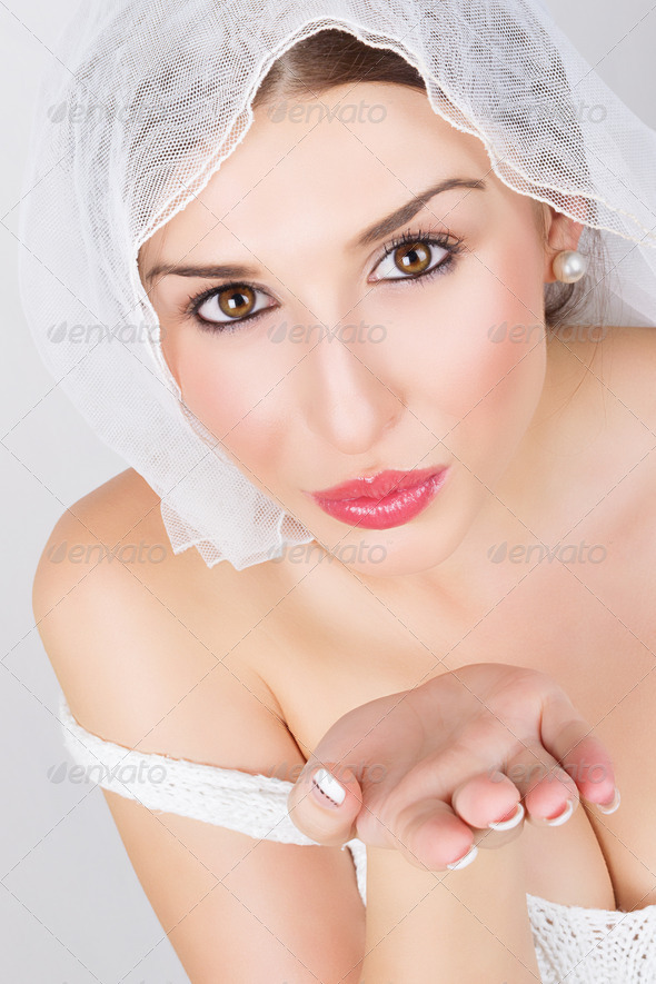 Young bride blowing kisses - Stock Photo - Images